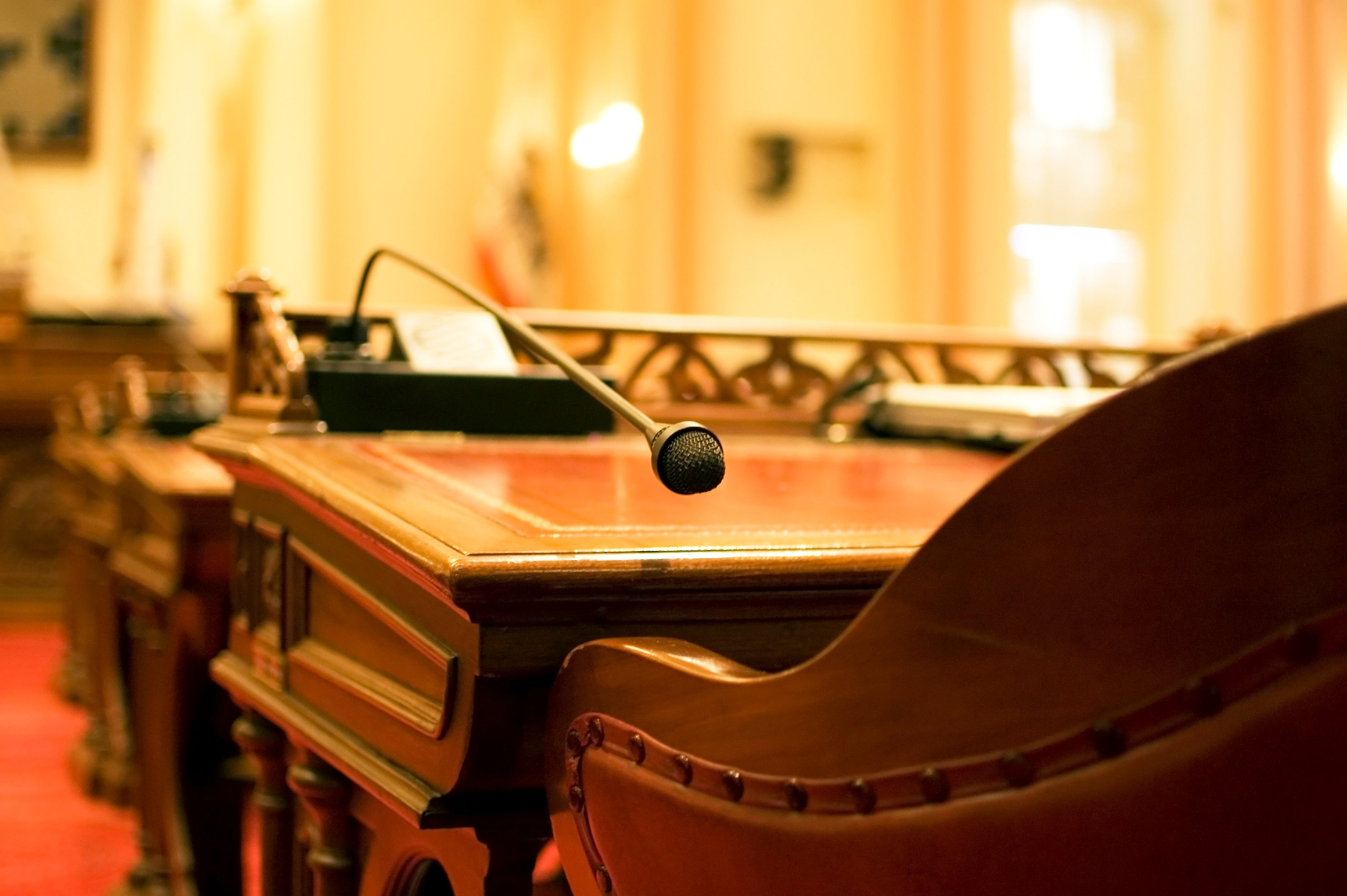 Microphone and empty chair in chamber of Congress