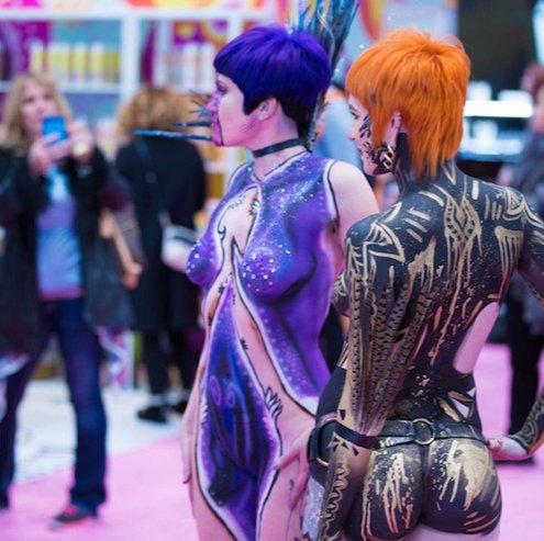Body painted models roaming the show floor. Photo courtesy of @tkhairgroup