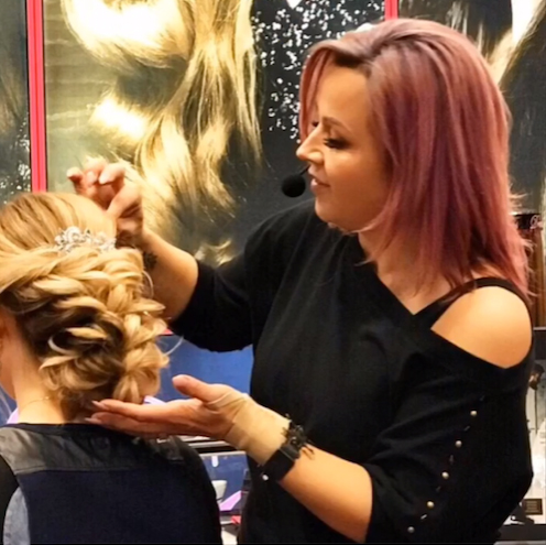 Beauty influencer @lalasupdos crafting an updo for the @dreamcatchershair team. Photo courtesy of @lalasupdos