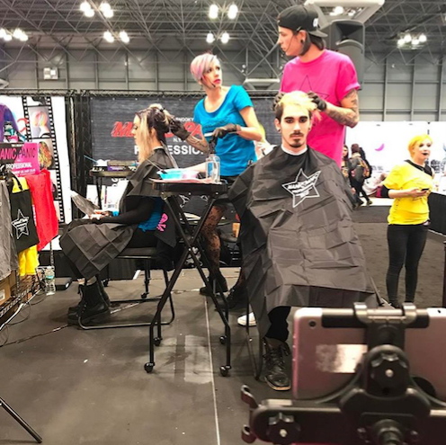Manic Panic giving a live demo on the show floor with their new pro line of color. Photo courtesy of @manicpanic