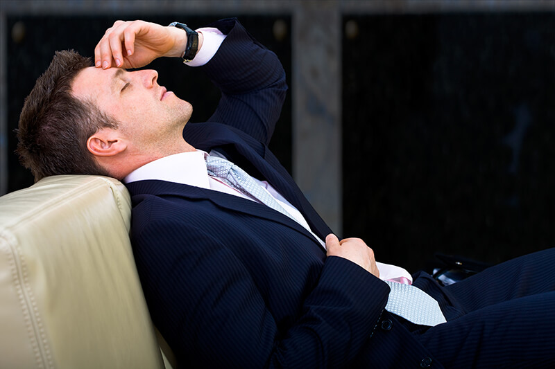Tired/Sleeping Businessman - nyul/iStock/Getty Images Plus/Getty Images