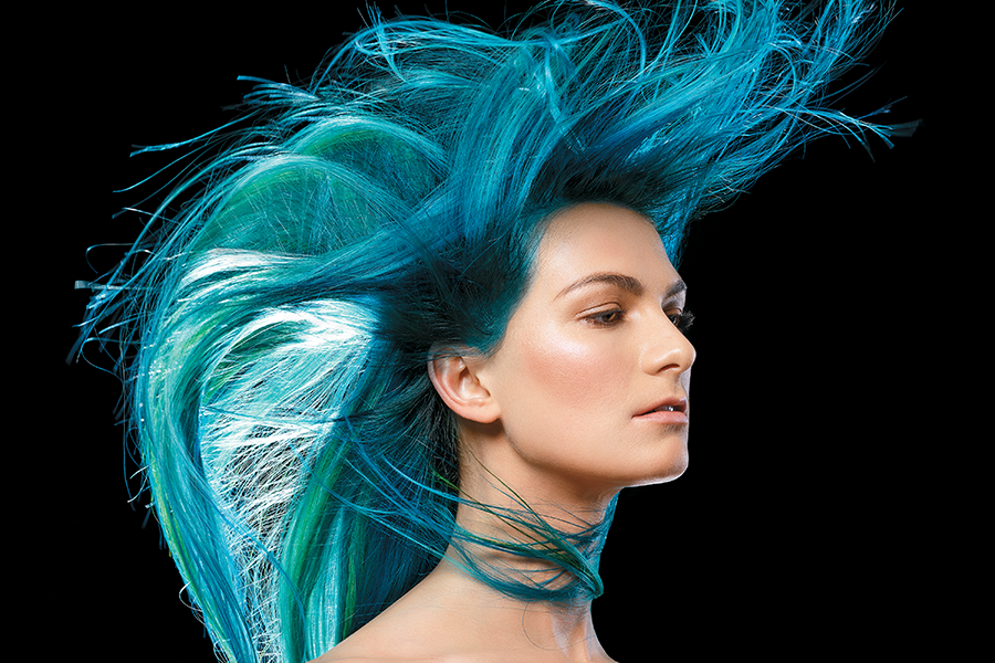 "Two weeks prior to the shoot, model Taylor Ferrao had unicorn hair with a black shadow root, then went back to brown—her previous colorist used Effasol and oxidative color. To protect the hair during the color correction, Peterson used CPR Color Pigment Remover before the transformation to ""Maliblue."" Peterson says: ''I was able to lift her evenly and place color where I needed to."