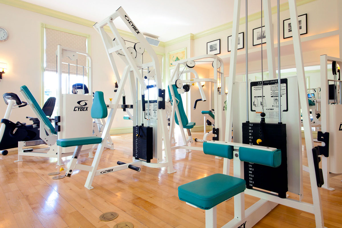 The fitness center is filled with Technogym equipment.