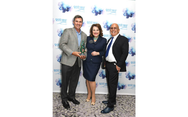 Lydia and David Sarfati with Roger Bell, CEO of AP Scott Trinidad Limited