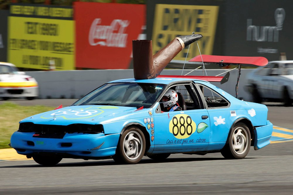 In the most recent race, the T-Bird became The Treachery of Images, complete with Citroën hood ornament, roof-mounted giant pipe, and Ceci n'est pas une citron lettering below the car number.