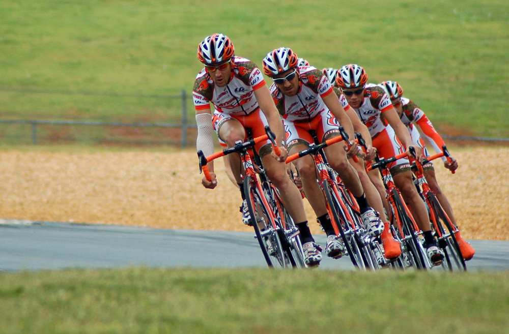 Cyclists in formation to minimize drag.