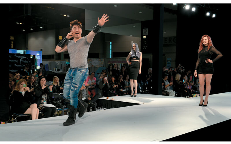 Guy Tang waves to his fans from the Main Stage.