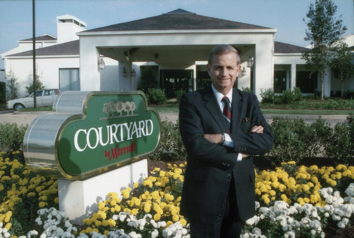 Bill Marriott outside a Courtyard by Marriott hotel in 1983.