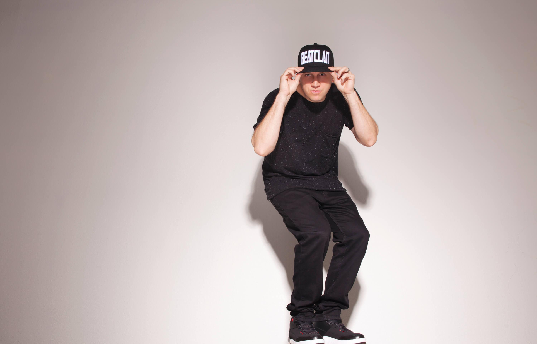 SKAM Artist DJ Hollywood standing in Beatclan cap - Meet the SKAM Artist