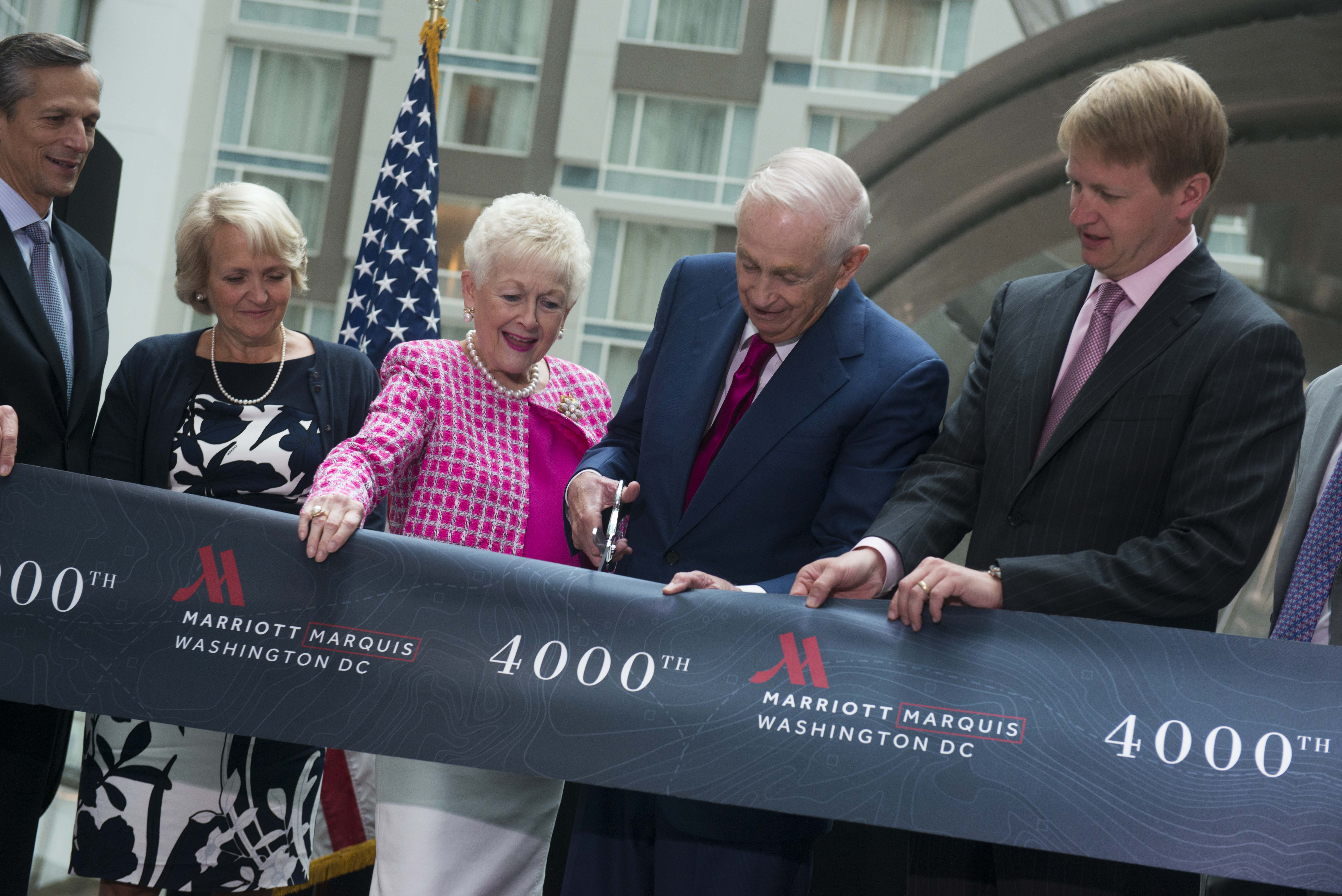 Bill Marriott and his wife, Donna, cut the ribbon of the Marriott Marquis in D.C. along with daughter Debbie and son David.