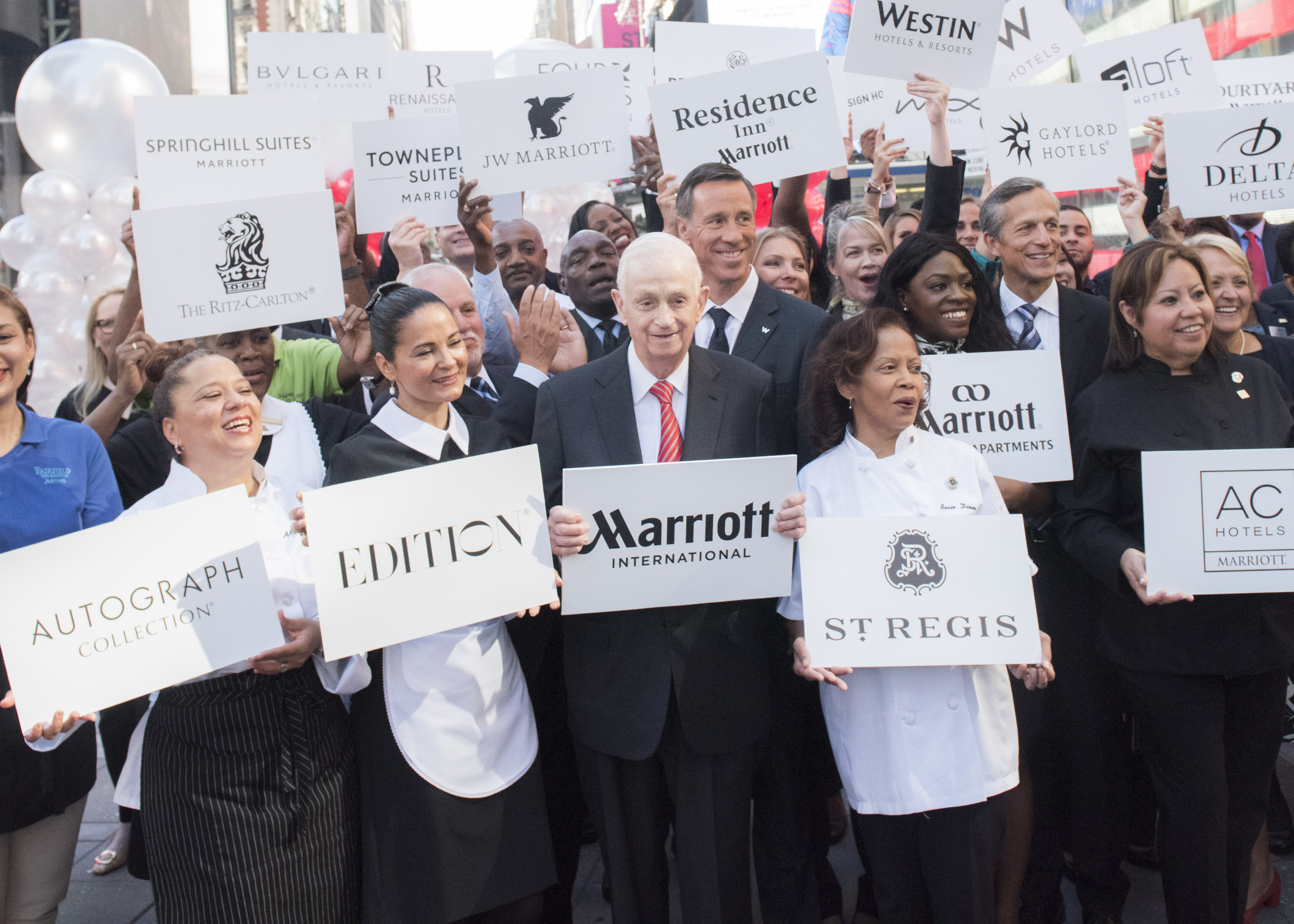 Bill Marriott in the middle of Times Square after Marriott's deal for Starwood.