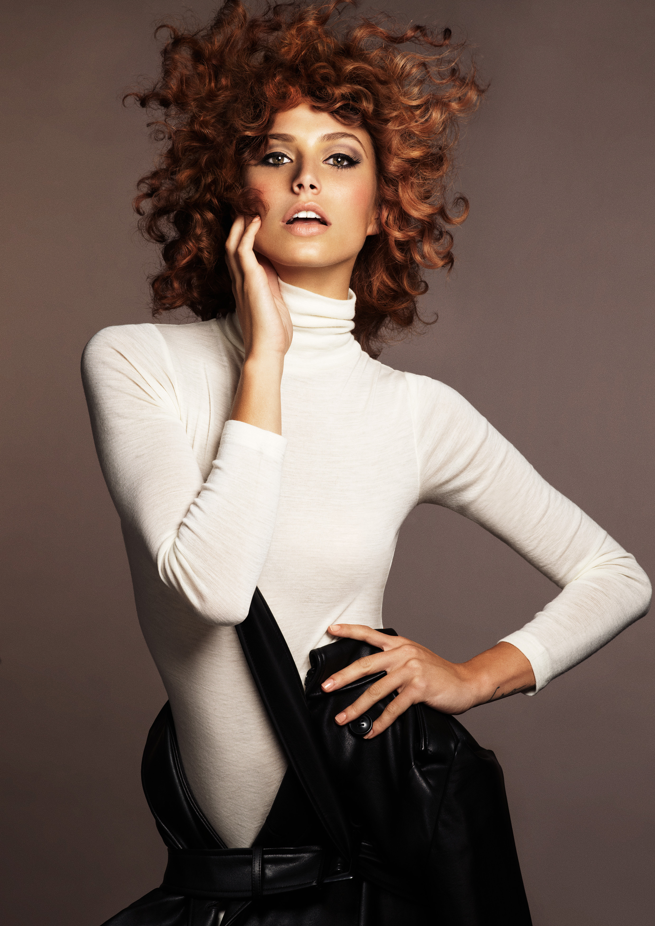 """""""Curls with dark mocha base color, ends flickering golden honey with hints of apricot."""""""
