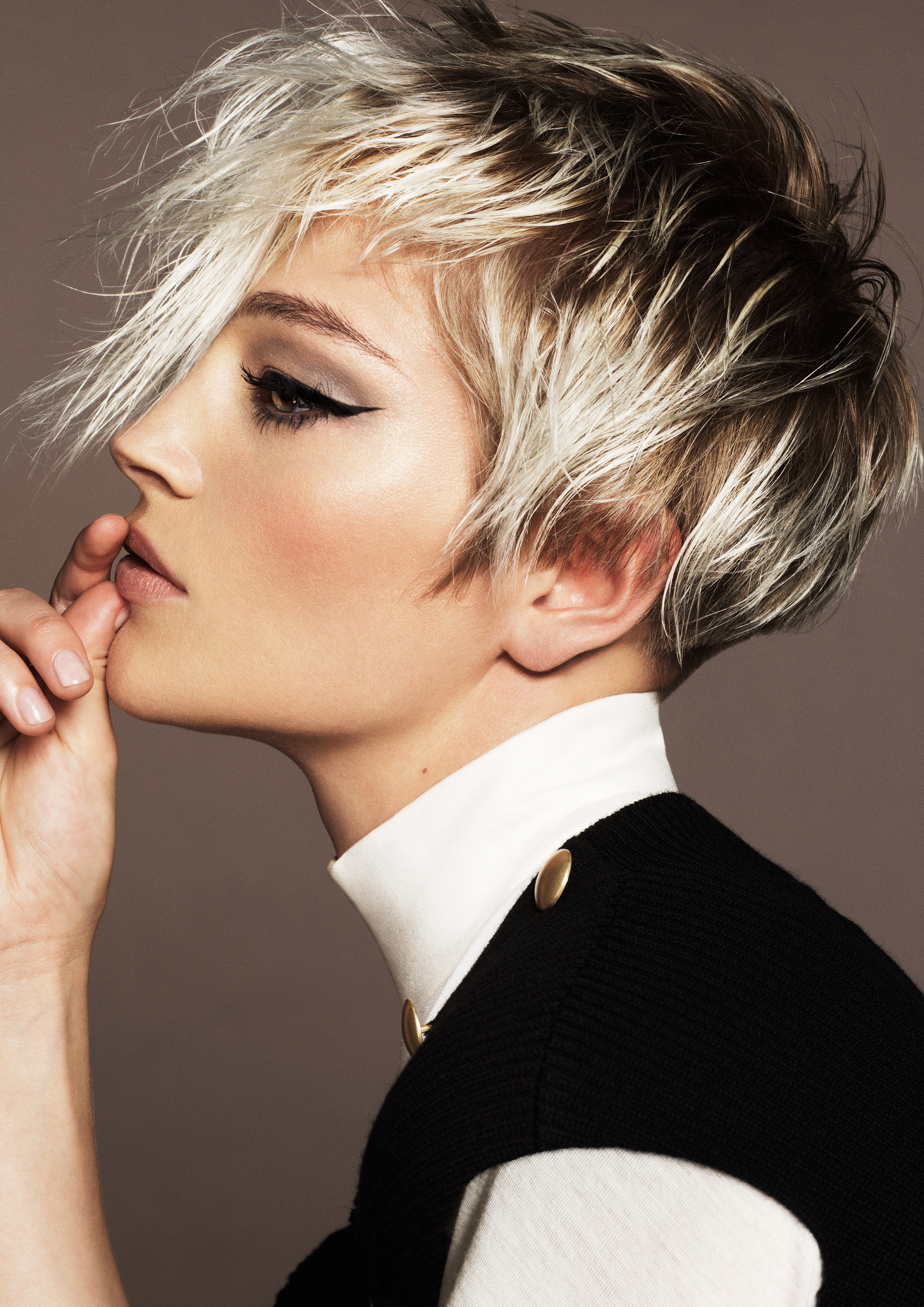"""Short, blonde, textured haircut with a charcoal flat base to accentuate highlighted ends."""