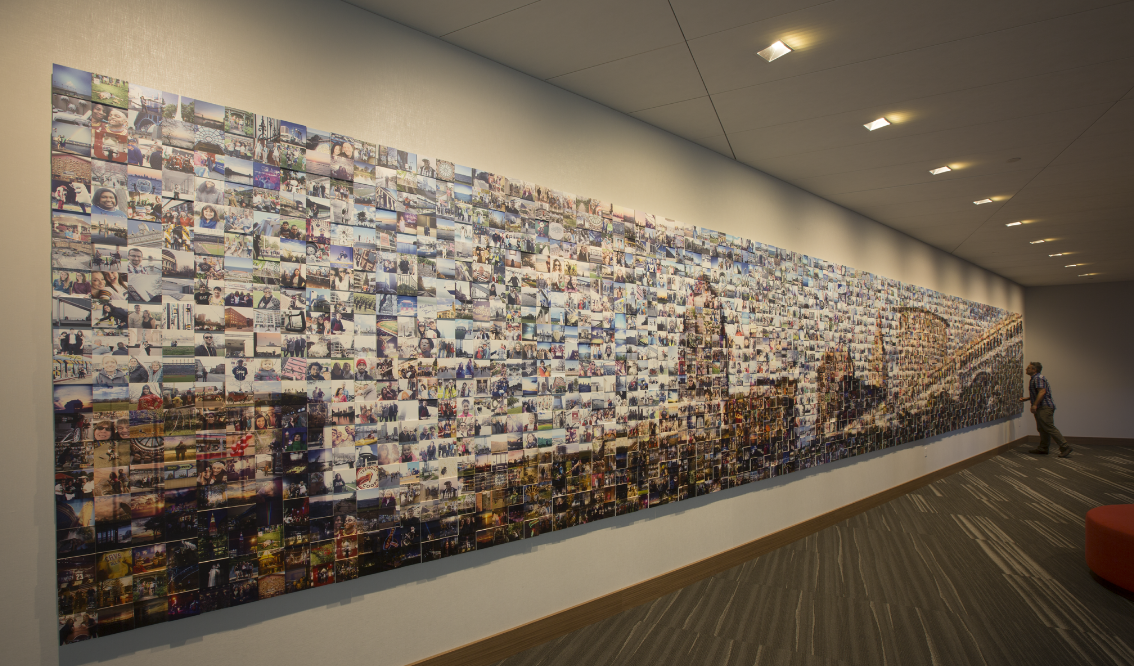 Kalisher sourced 3,000 selfies of Cleveland residents, turning the photos into a skyline mural at the Hilton Cleveland Downtown.
