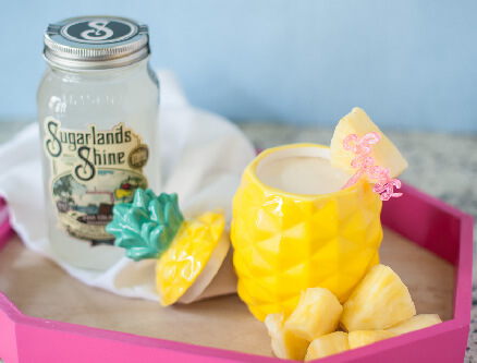 Piña Colada Milkshake from Sugarlands Distilling Co. - Piña Colada recipes for National Piña Colada Day and the summer