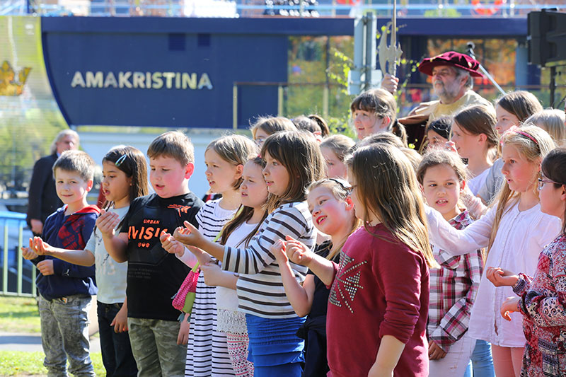 Two dozen school children from Goethe Schule in Lahnstein, Germany, practiced for weeks to perform newly composed songs for VIP guests gathered to celebrate the AmaKristina christening.