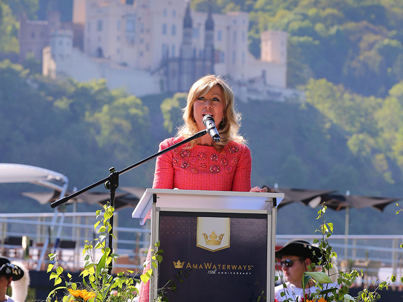 Against the backdrop of the ancient Stolzenfels Castle, AmaWaterways Executive Vice President and Co-Owner Kristin Karst addresses more than 200 VIP guests about her journey to being a godmother of the new AmaKristina.