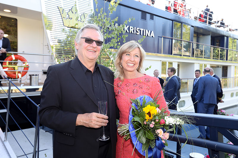 AmaWaterways President and Co-Owner Rudi Schreiner joins wife, co-owner and godmother Kristin Karst immediately after her energetic heave of a champagne bottle officially christened the AmaKristina