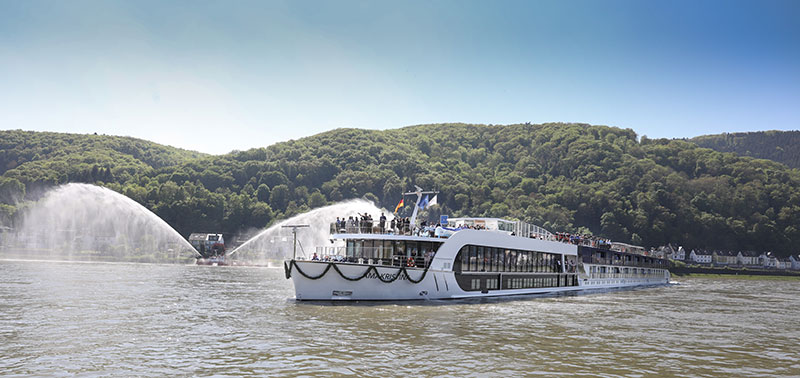 Lahnstein, Germany pulls out all the stops for the city's first-ever ship christening. The town's fireboat shoots water cannons along the Rhine as the AmaKristina, dressed in festive bunting, arrives to dock along the Rhine riverbank.