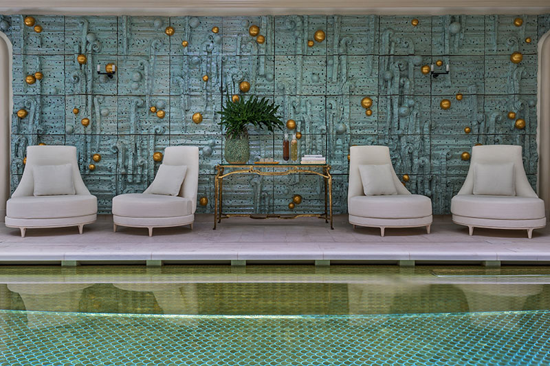The indoor pool incorporates 17,600 gold mosaic tiles and a mural by Peter Lane