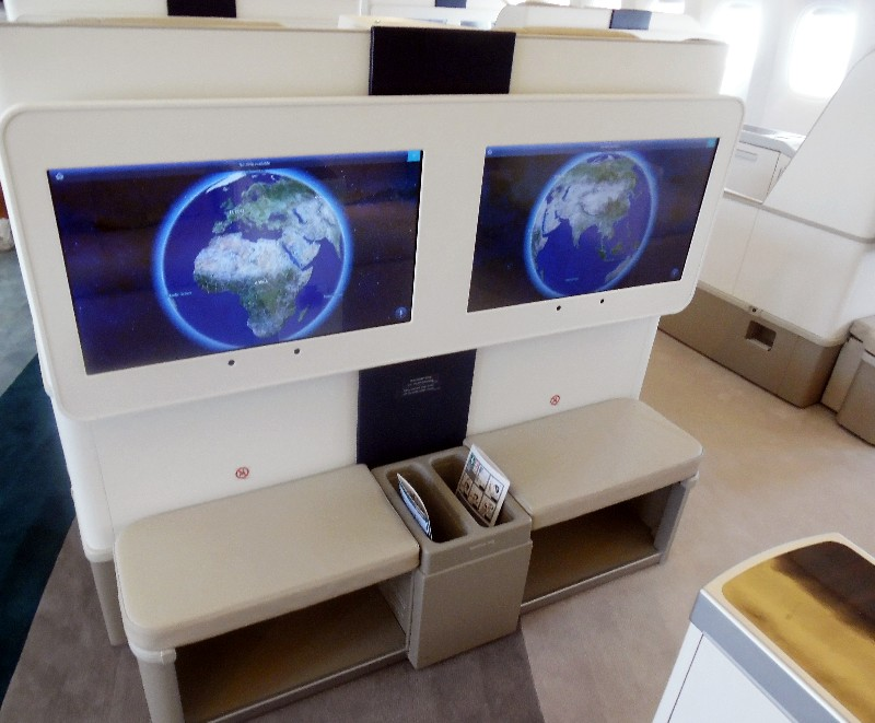 "Personal 24"" Panasonic monitors, a bench and storage compartment are provided at each Crystal Skye seat"