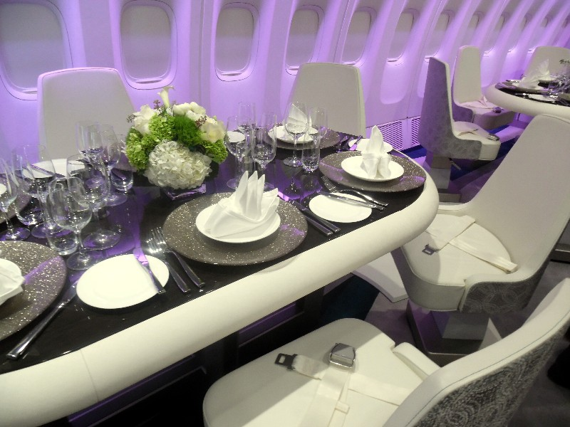 One of Crystal Skye's Dining Table/Chairs in the forward part of the Boeing 777