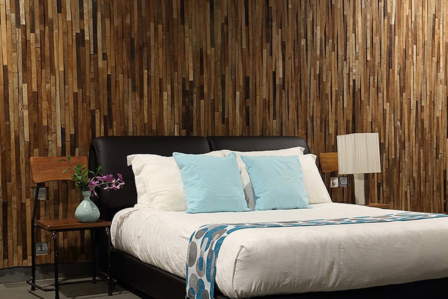 Kayu V-wood wall cladding is a meshed tile arrangement of reclaimed Indonesian teak with a tapering relief.