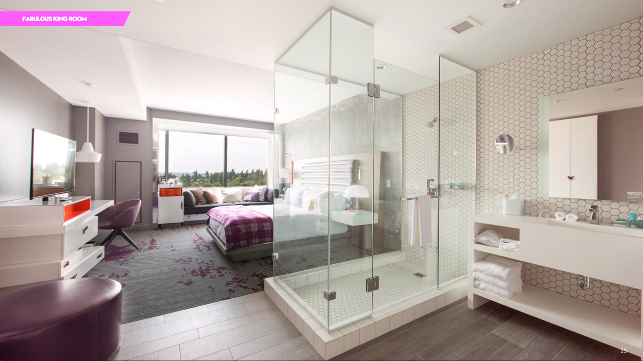 King guestrooms are divided by a see-through shower, and have plenty of seating.