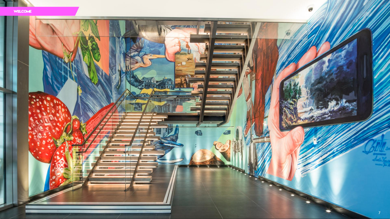 The main reclaimed wood staircase is surrounded by colorful street art from international artist Gaia