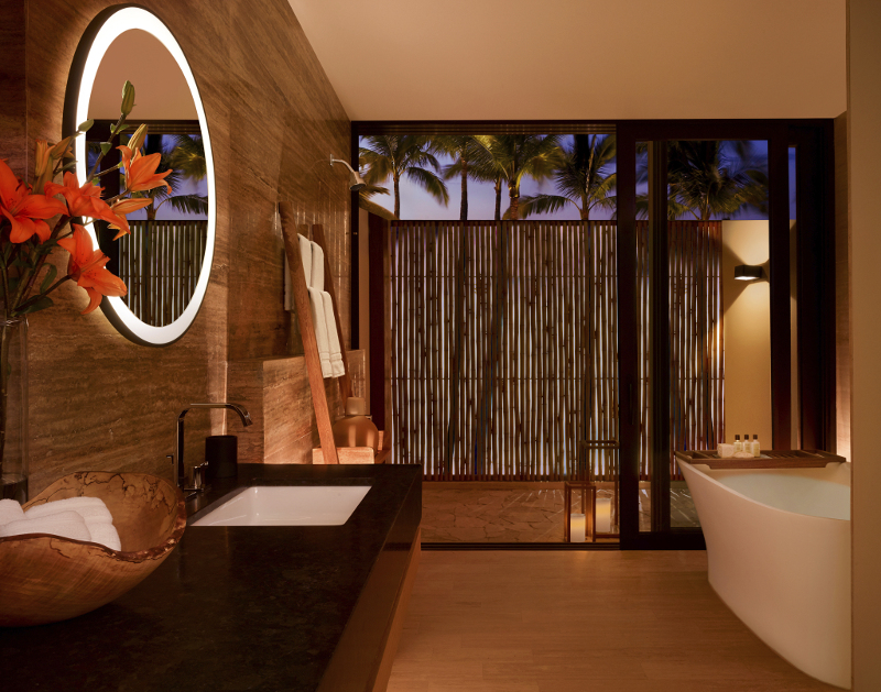 The bathroom of a Montage Los Cabos suite, with outdoor shower.