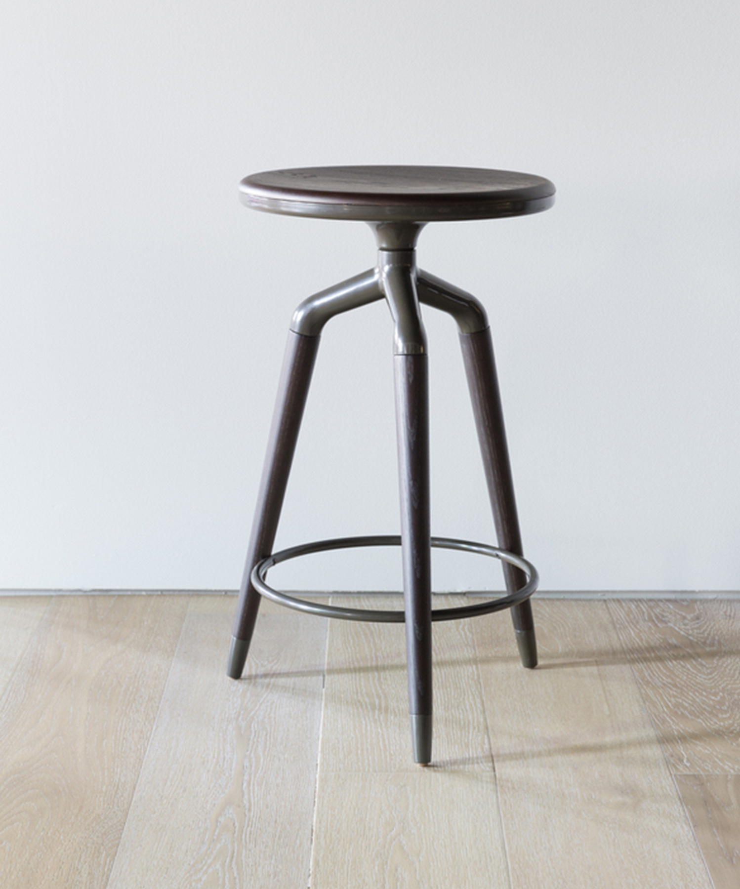 Enpointe has slender legs that extend down in slim points, as well as metal accents. The seat has a slight dip to it for added comfort.