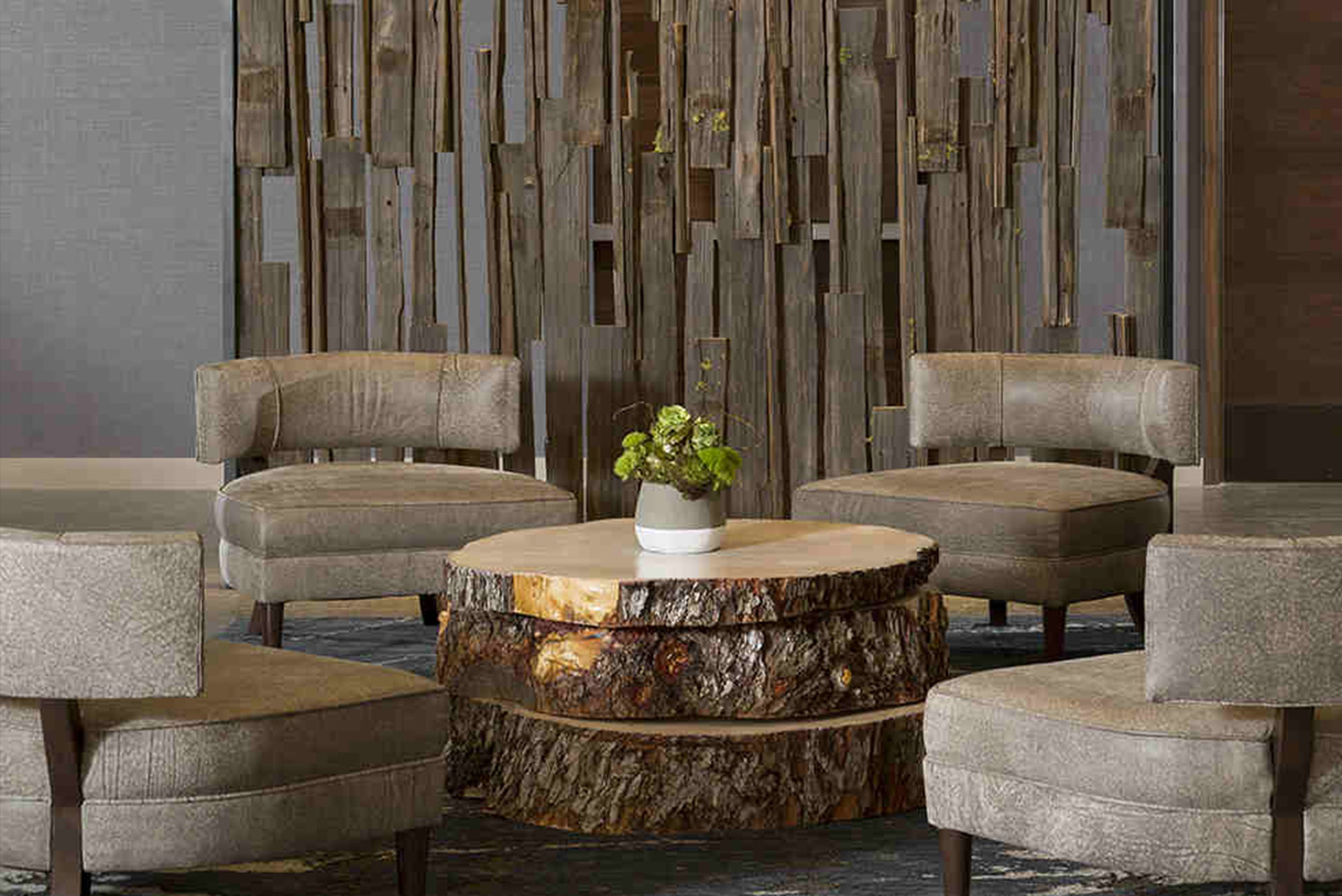 There are stone fireplaces and leather furniture to allow guests to enjoy views of the lake.
