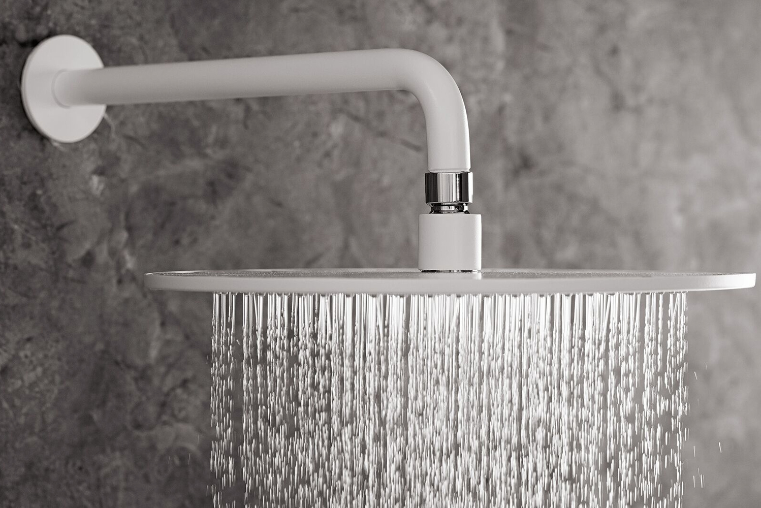 "Offering an 8"" low-profile rain showerhead, the fixture has 169 no-clog, easy-to-clean rubber spray nozzles."