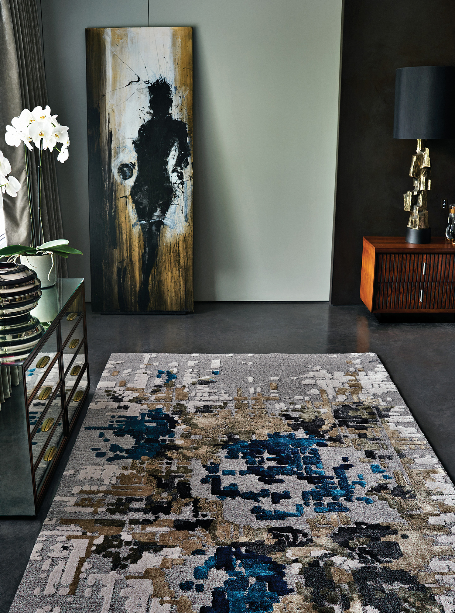 Pixel collection's base is first tufted with the loop technique combining the wool and the viscose.
