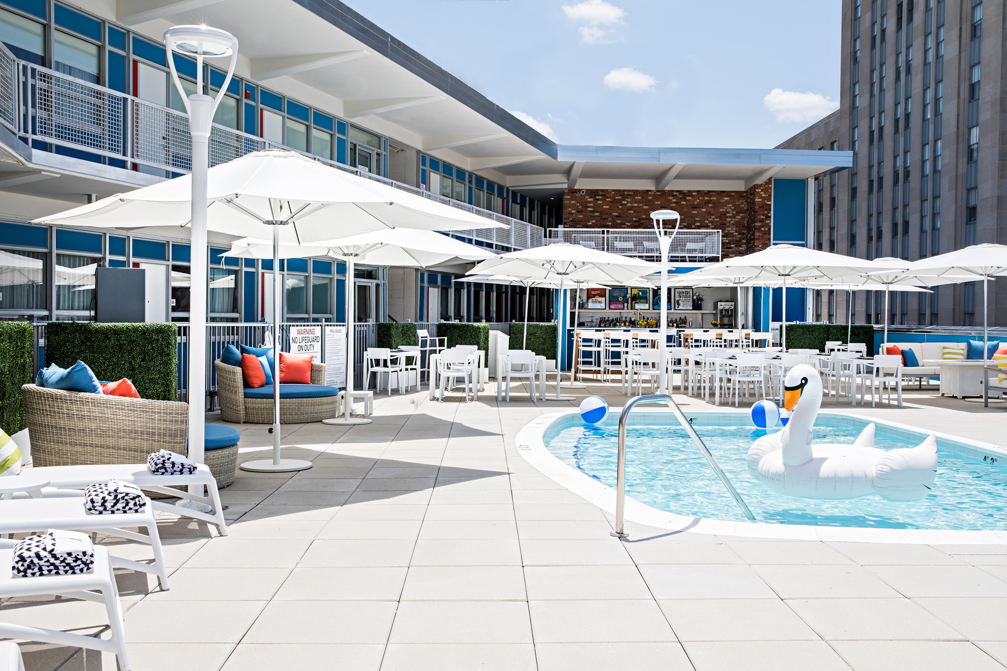 The pool deck is surrounded by a third of the guestrooms.