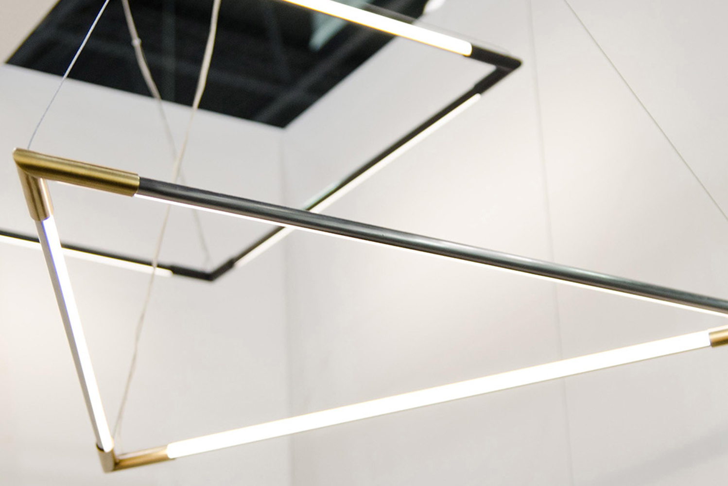 Four geometric interpretations are designed with interchangeable elements for a custom lighting solution.