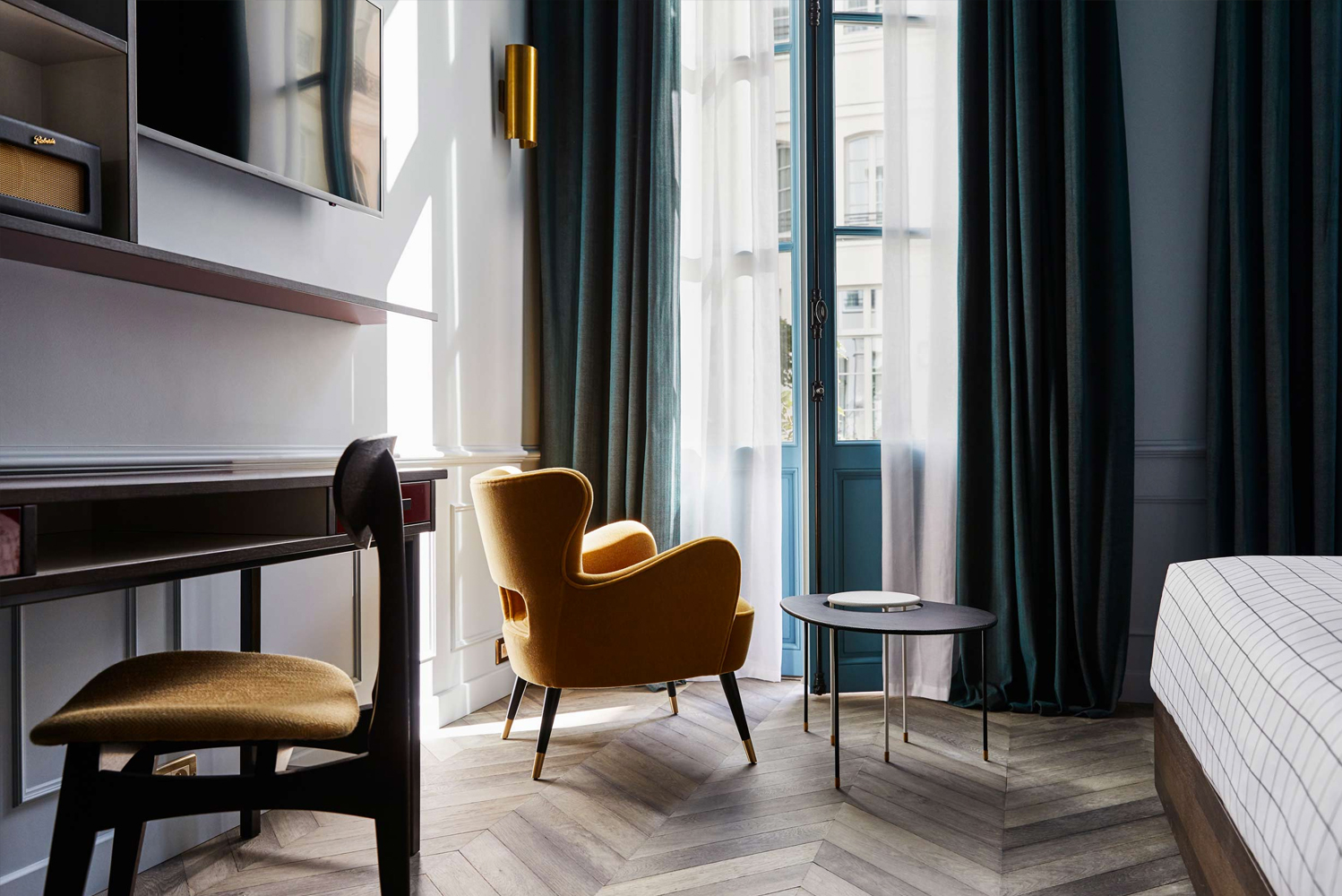 Throughout the hotel, the designers incorporated pieces that were created or inspired by some of the country's furniture and lighting designers.