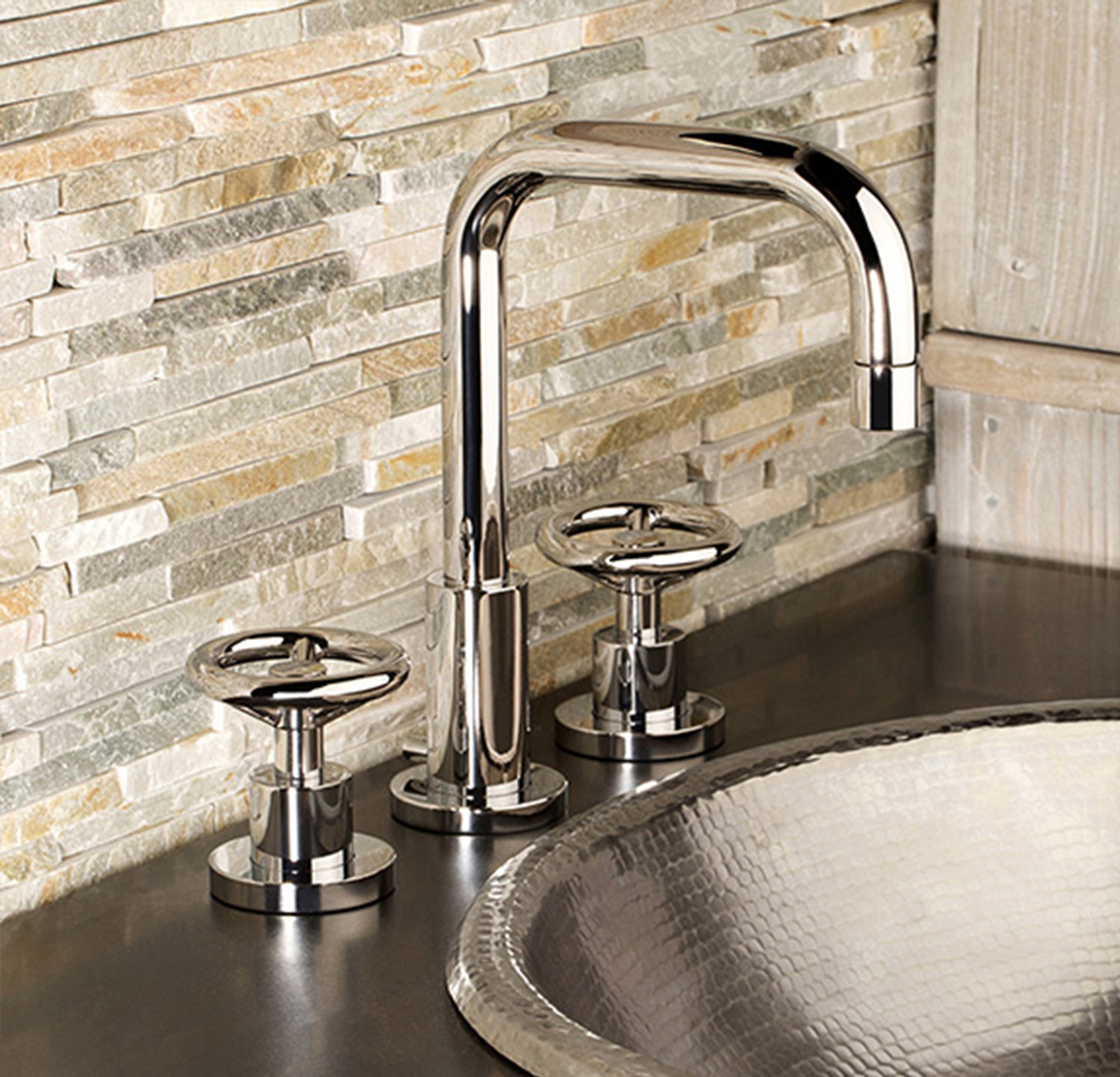Tyler comes equipped with identical handles but features a geometrically shaped spout.