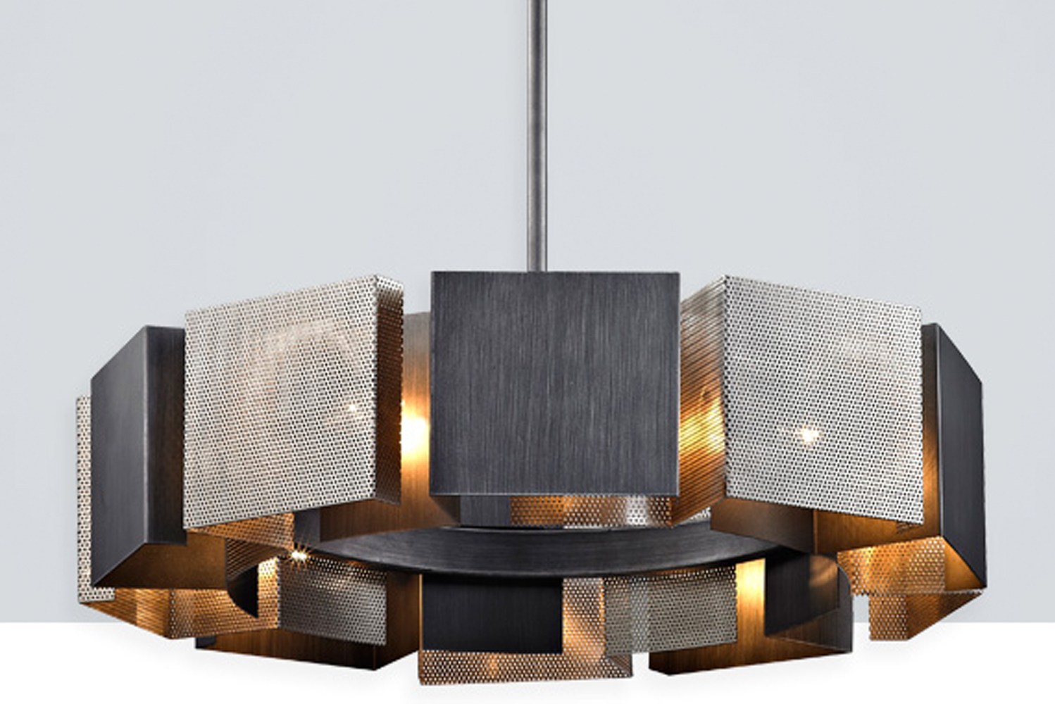 Impression by Troy Lighting is a modernist centerpiece comprised of perforated, handworked iron squares.