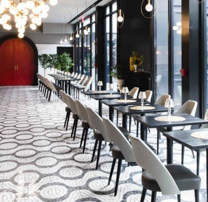 The former plaza-level space of La Bottega was recreated with custom '60s-inspired curvilinear pavers.