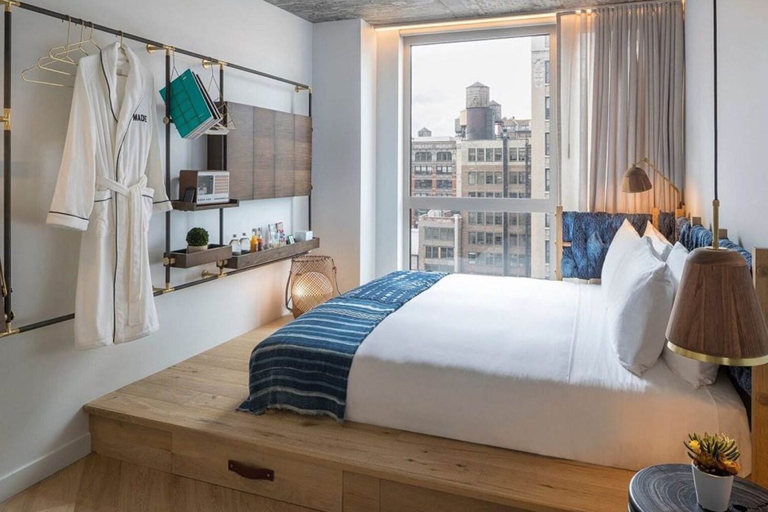 Studio MAI designed the guestrooms with an urban international design aesthetic.