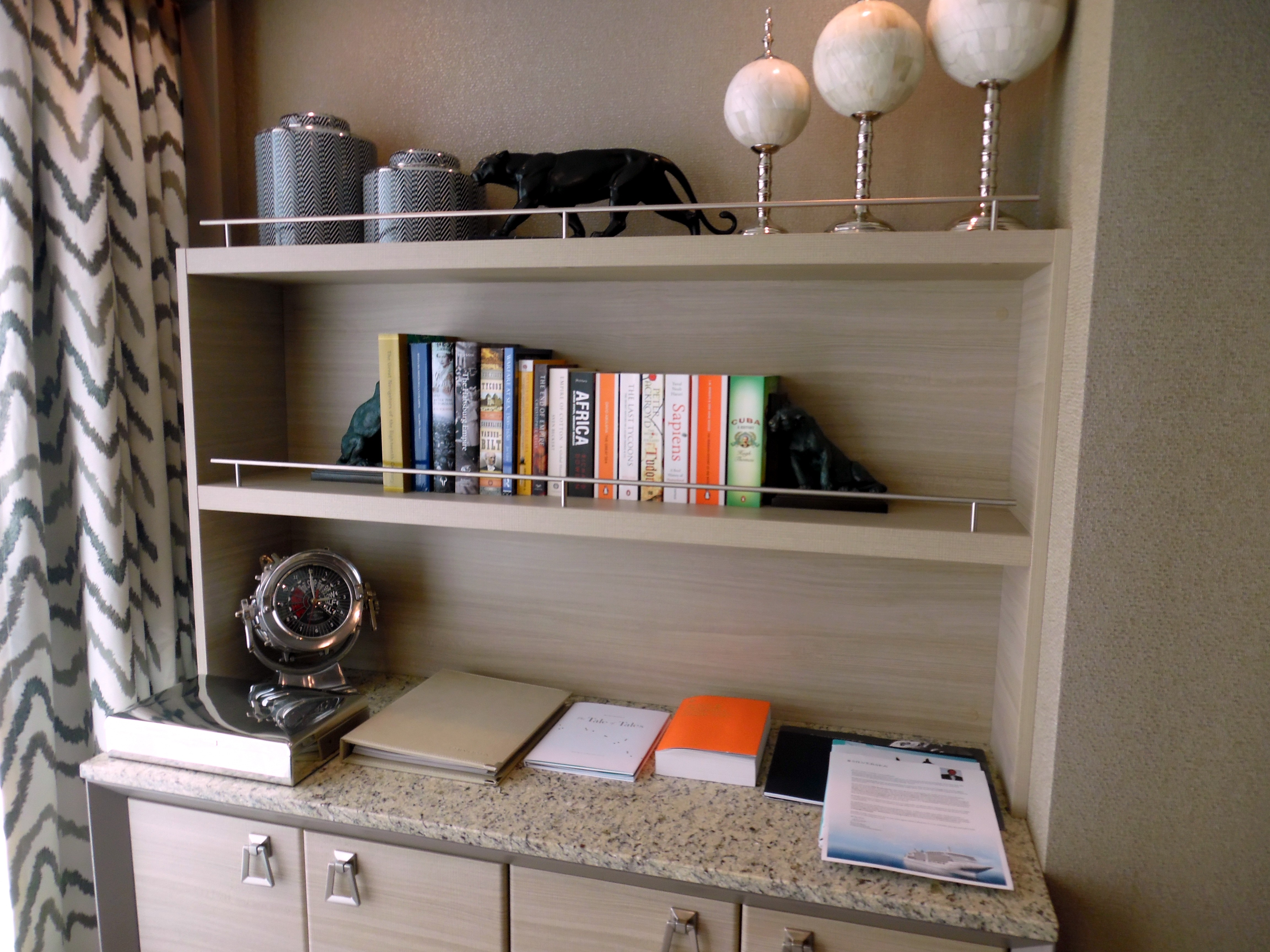 Bookshelves with personal items and books from the Rome home of Manfredi Lefebvre