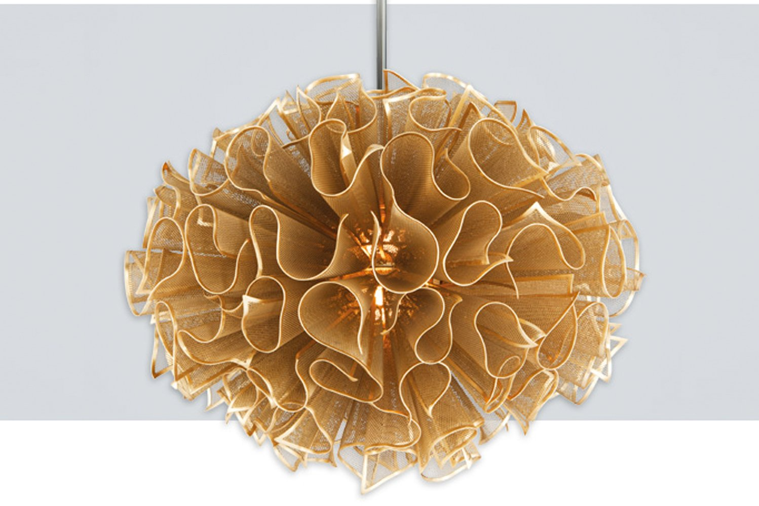 Pulse by Corbett Lighting is a sculptural design made of handcrafted iron mesh finished in gold leaf.