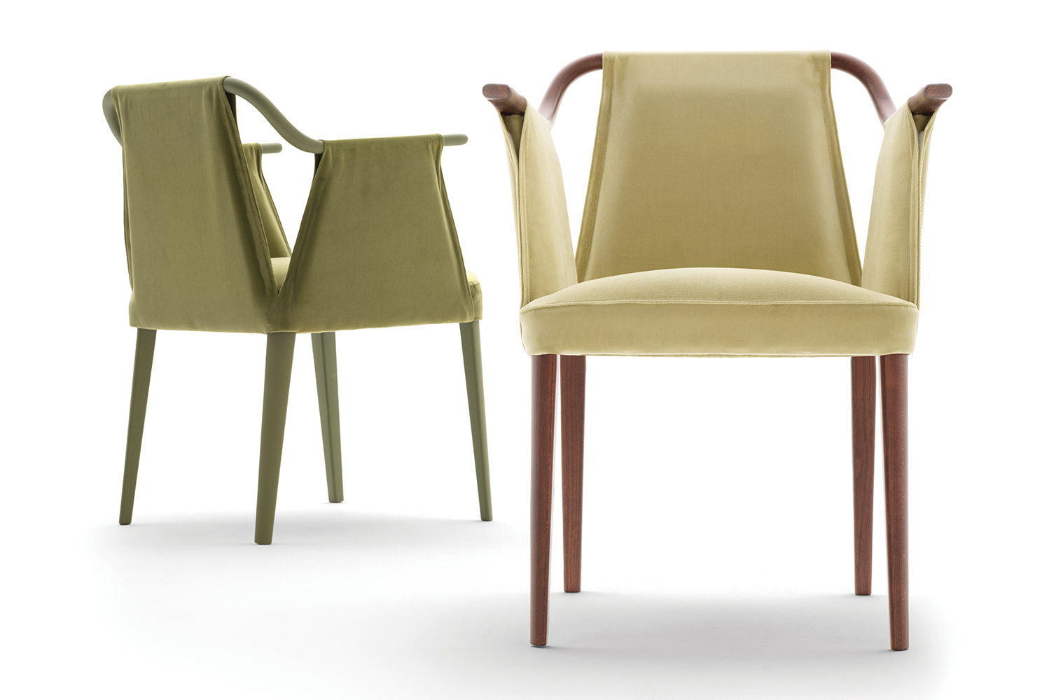 Sayo forms a continuous silhouette since the armchair's upholstery loops through a slender Beech frame to form armrests.
