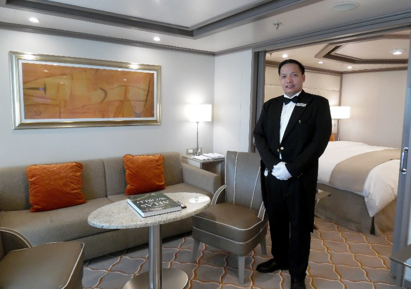 A butler stands ready to serve -- making reservations or helping guests unpack.