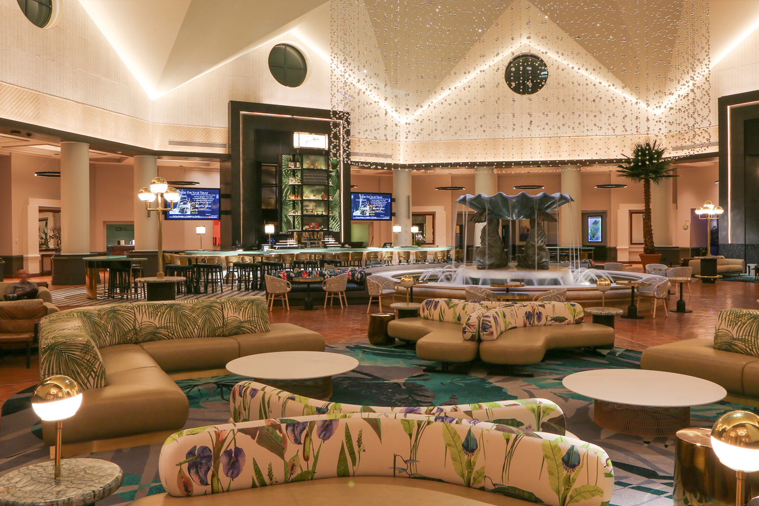 The Dolphin Resort lobby, designed by ICRAVE, has new look with a new geometric ceiling, enhanced lighting and more than double the amount of guest seating.