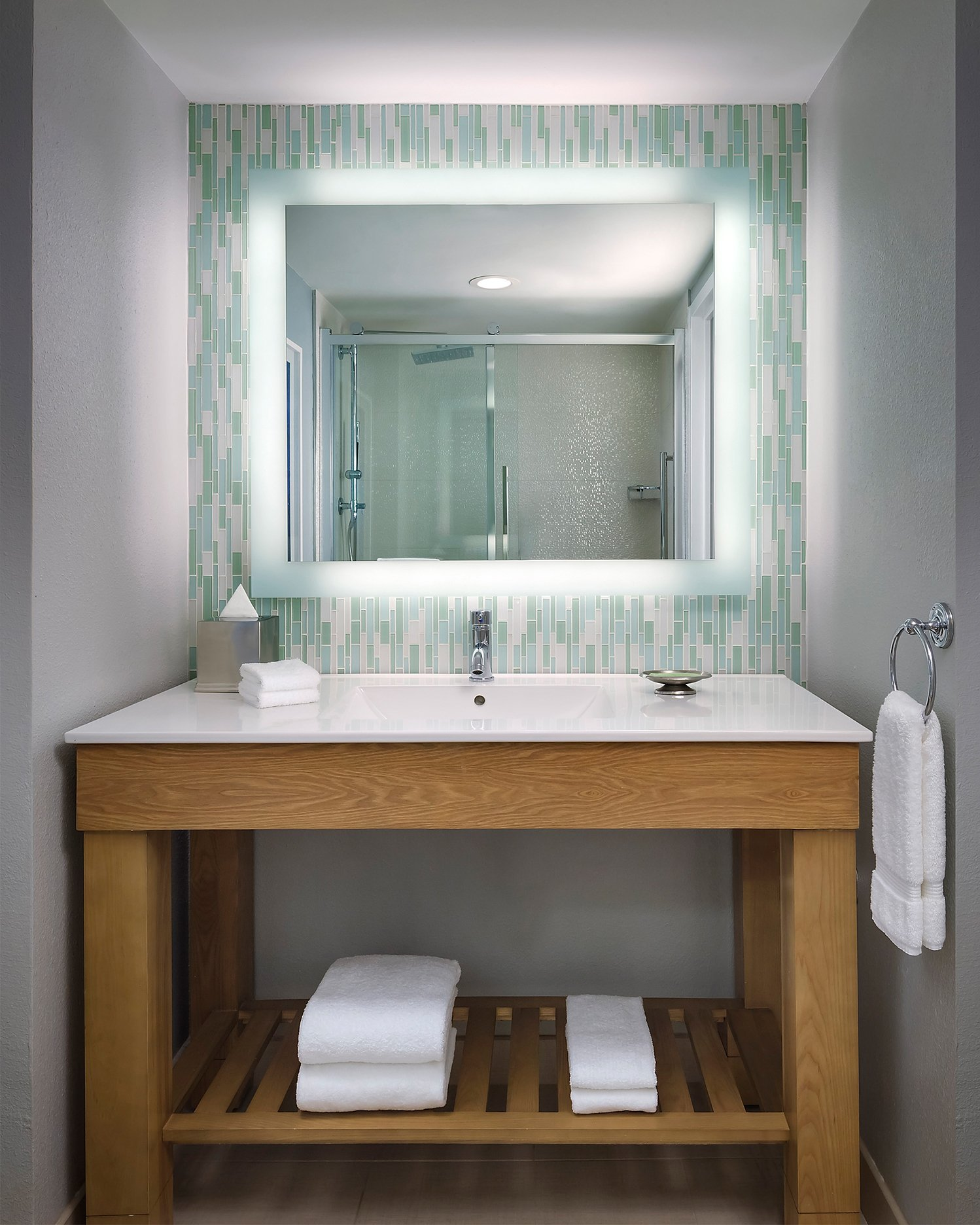 The new rooms use hues of white, blue and gray; and come with multi-functional furniture and new bathrooms with vanities with backlit mirrors on iridescent glass tiles.