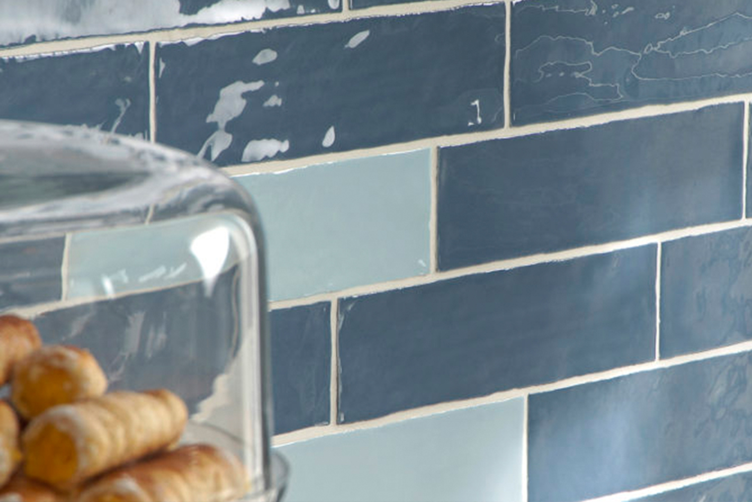The collection of glazed ceramic subway tiles has a smooth uneven finish, giving the product a weathered look.