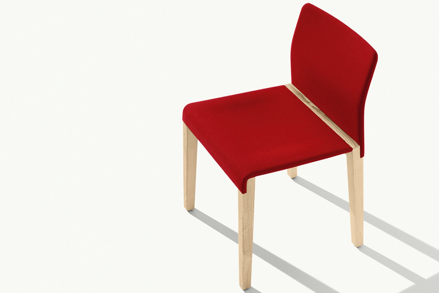 Designed by Giulio Iacchetti, Dalton has a clean, graphic design with an innovative construction and solid wood frame.