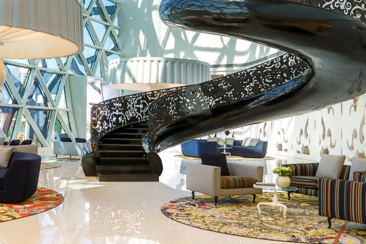 Wanders' signature floating staircase and hand-painted One-Minute Delft blue vases can be seen throughout the property.